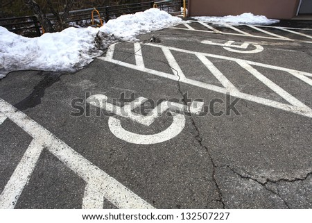 Wheel chair symbol in parking lot and snow in Japan
