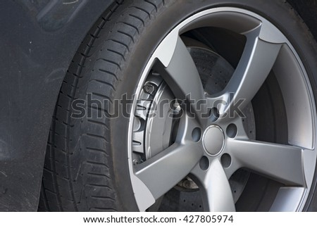 Wheel closeup with brake disc and caliper, alloy wheels