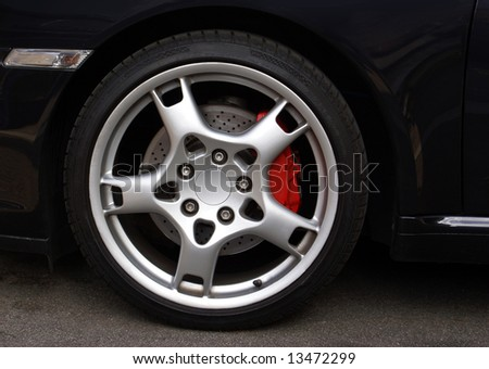 Wheel from an expensive sports car coupe - stock photo