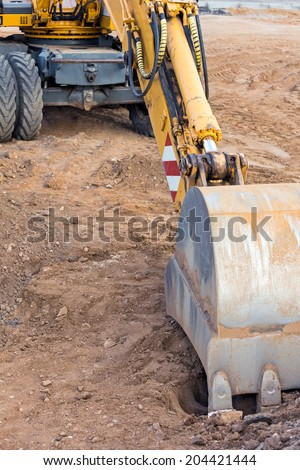 Wheel loader excavator with backhoe at construction site - stock photo