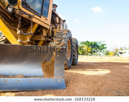 Wheel loader Excavator with backhoe unload sand at eathmoving works in construction site - stock photo