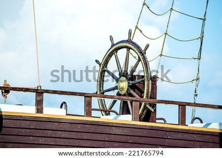 wheel of an old sailing ship - stock photo