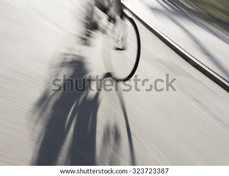wheel of bicycle with shadow in blurred motion