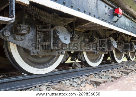 wheel of locomotive on railway, vintage, train - stock photo