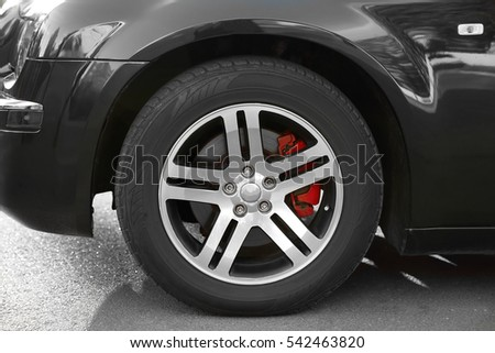 Wheel of luxury black car, closeup