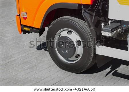 wheel of new truck closeup - stock photo