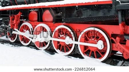Wheel retro locomotive snow winter, red wheels at the back of - stock photo