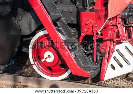 Wheel the retro steam locomotive on railway rails - stock photo