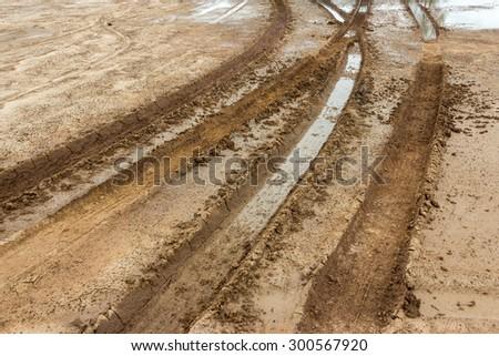 Wheel tracks on marshy road after raining - stock photo