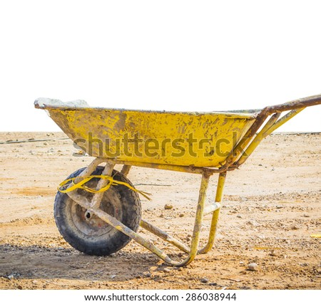 wheelbarrow for construction parked with isolated - stock photo