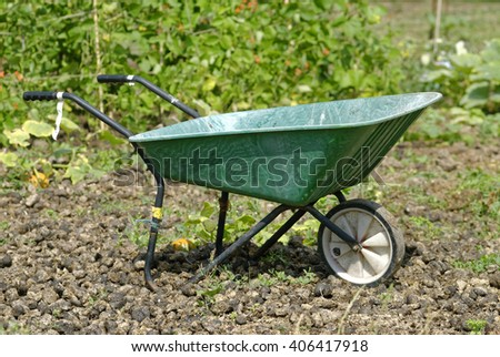 Wheelbarrow in an Allotment Garden where land is made available for personal cultivation of fruit and vegetables.