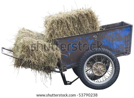 Wheelbarrow with hay on the white background - stock photo