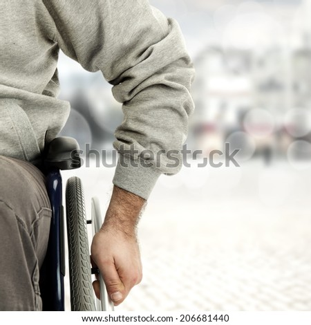 wheelchair and hand  - stock photo