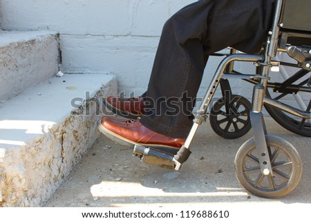Wheelchair-bound person near stairs. Concept of limitations and accessibility. - stock photo