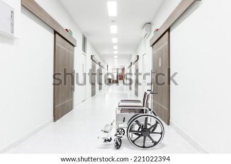 Wheelchair on corridor of hospital  - stock photo