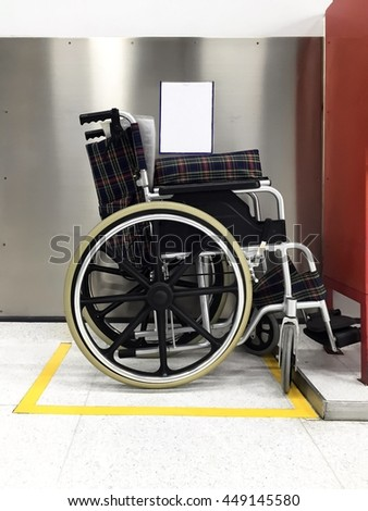 Wheelchair preparing for patient in factory. - stock photo