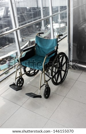 Wheelchair service in airport terminal - stock photo