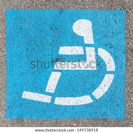 wheelchair sign at the parking lot  - stock photo