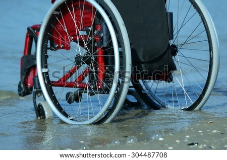 wheelchair stuck in the sand on the seashore