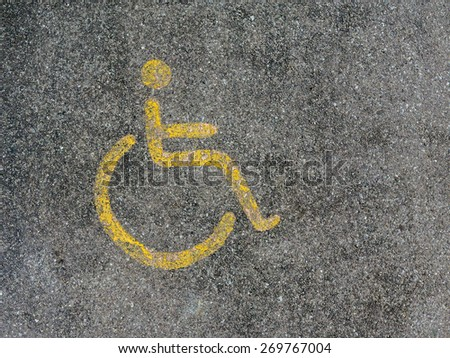 wheelchair symbol on the road