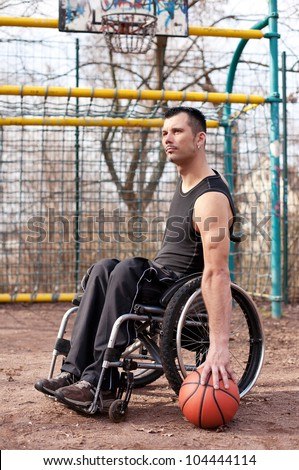 wheelchair users in sports, with wheelchair, strong man