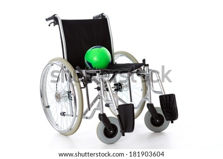 wheelchair with ball - stock photo