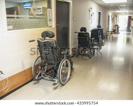 Wheelchairs in the hallway of a nursing home - stock photo