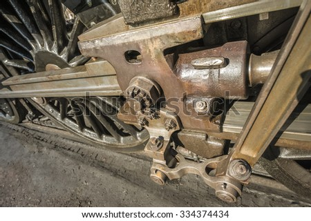 wheels and coupling rods on a vintage steam locomotive - stock photo