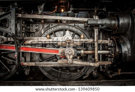 Wheels of an ancient steam train - stock photo