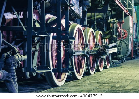 Wheels of locomotive in the night