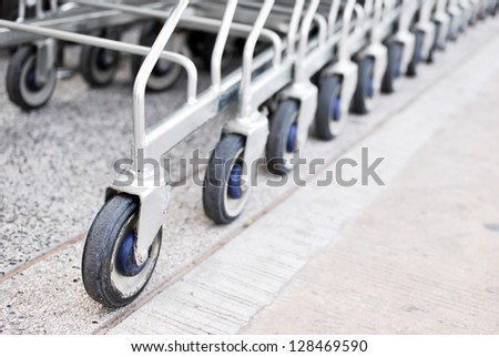 Wheels of shopping carts - stock photo