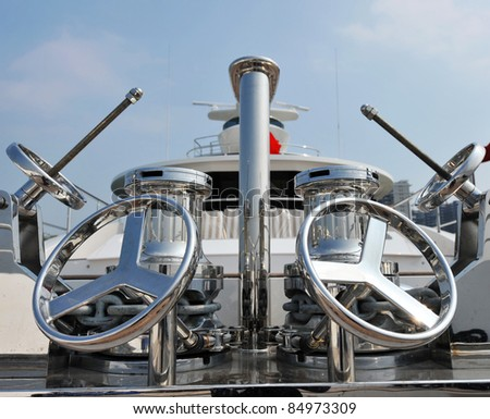 wheels on the deck of a luxury yacht. - stock photo