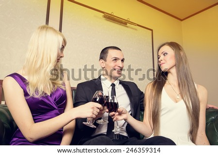 When a Love Triangle is not really a Love Triangle. Lovely Couple. Love story about a man and two women - concept of a love triangle. Love, betrayal, jealousy in a relationship between man and woman. - stock photo