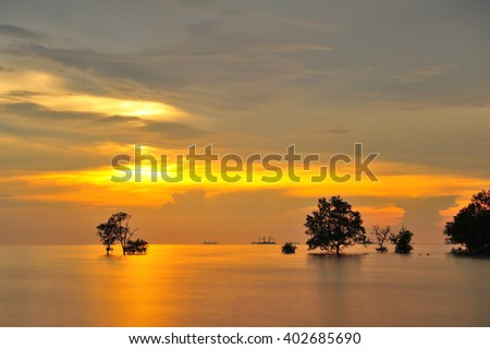 when dusk arrives and the ocean tides - stock photo