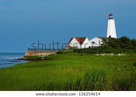When Lynde Point lighthouse was rebuilt, the tower was much higher, and windows were placed facing the water for keepers to watch from. - stock photo