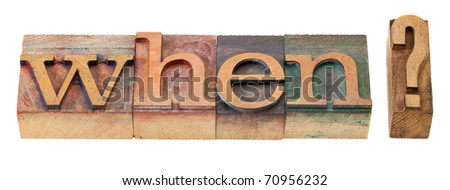 when question in vintage wood letterpress printing blocks, stained by color inks - stock photo