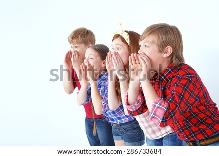 Where are you. Little brisk children holding their hands on their faces and calling friens while standing together isolated on white background. - stock photo