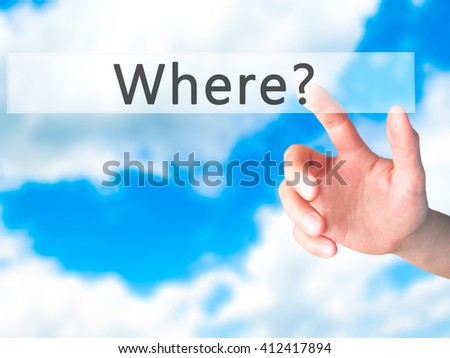 Where - Hand pressing a button on blurred background concept . Business, technology, internet concept. Stock Photo