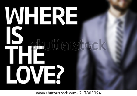 Where is the Love? written on a board with a business man on background - stock photo