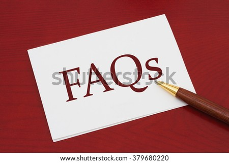 Where to get the FAQs Card, White Greeting card with text FAQs on a red wood background - stock photo