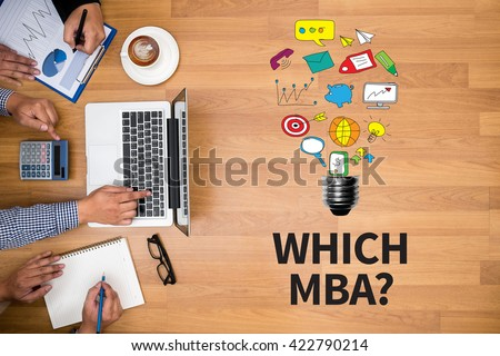 WHICH MBA? Business team hands at work with financial reports and a laptop - stock photo