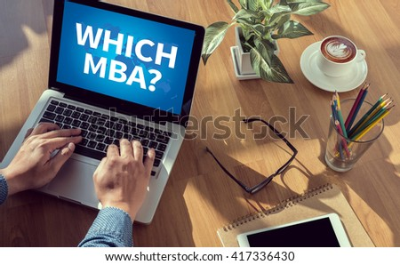 WHICH MBA? man hand on table Business, coffee, Split tone - stock photo
