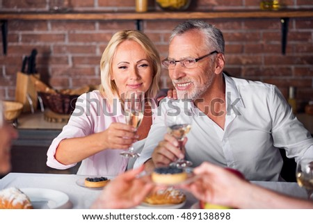 While heterosexual couple tasting wine at restaurant