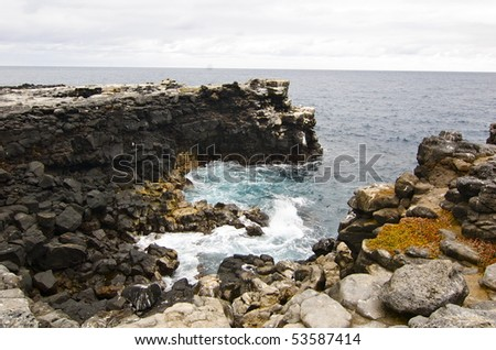 While on tour in the Galapagos island I found this serene environment where the water was crashing on the rocks below. Isla Santa Fé - stock photo
