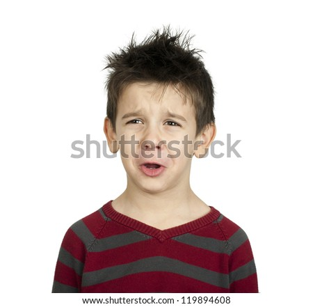 Whiny little boy close up. White isolated crying child - stock photo