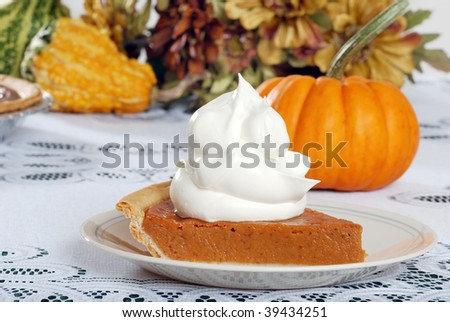 whip cream loaded on pumpkin pie - stock photo