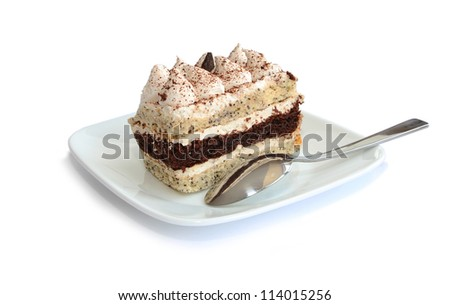 whipped cream cake with spoon on white plate isolated on white background