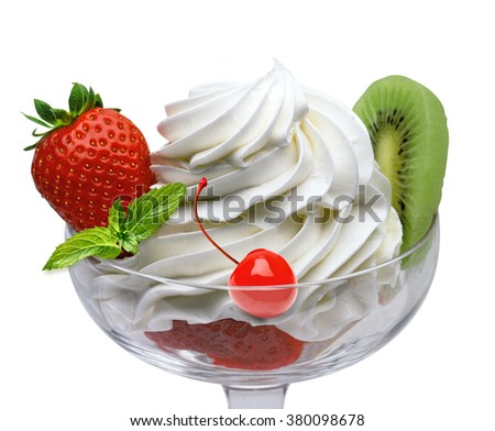 Whipped cream in cup with fruits on white background - stock photo