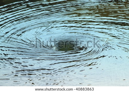 whirlpool spinning, making strange and beautiful circles - stock photo