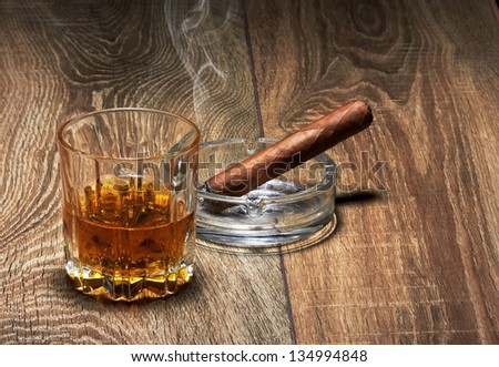 Whiskey and Cigar on black background - stock photo